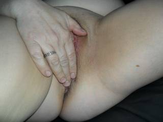 here she's fingering her pussy for me...horny