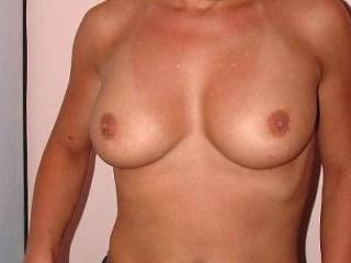 Gorgeous!! Love to suck on those nipples for you! And I lvoe those fantastic lips of yours... anything you fancy sucking? ;O)
