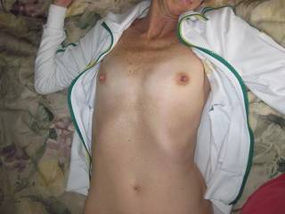your tits are hot.  i want to suck your nipples