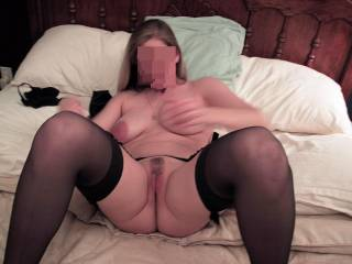 I\'m about to spread my wife\'s legs apart and penetrate her warm tight vagina.