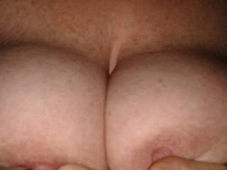 Great pic! Would look so much better with my cock between those lovely suckable tits.