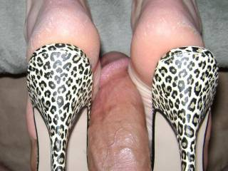He had a foot fetish.... I gave him a foot wank.... he shot his load all over my heels