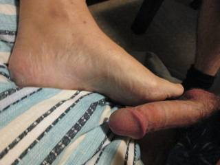 As hubby was licking my pussy I was rubbing his cock with my foot