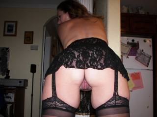 Milfy dressed for success and letting us check out her gorgeous pink pussy