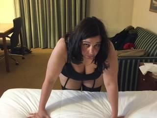 Bent over in hotel room