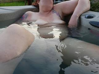 Chilling in the hot tub at the Holiday cabin.