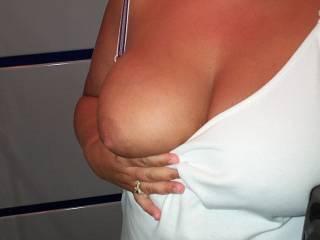 Very sexy! I love flashing photos! Great breast!