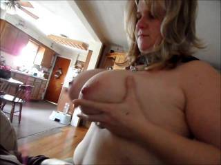 A couple of clips of my wife playing with her huge tits. Tell us what you think of them or what you would like to see.
