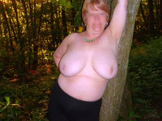 Showing her tits outdoors