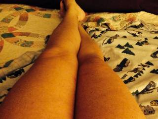 I love to touch and feel so yes, I would love to massage, stroke and kiss your sexy legs and then wrap them around my head and shoulders as I lick and kiss your sweet pussy!!  Oh and you have very cute feet!