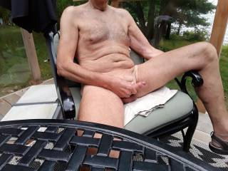 Naked at the cottage. Sure would like to have someone sucking on this cock.