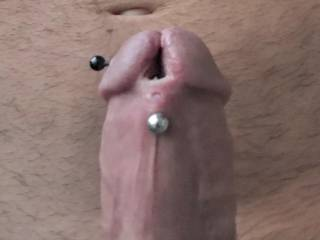 Split and pierced cock head.