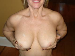 cum on tits with smile