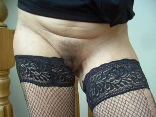 very hot there sexy lady fishnet stockings and the sweetest hairy pussy ... hot sexy and mouth watering!!