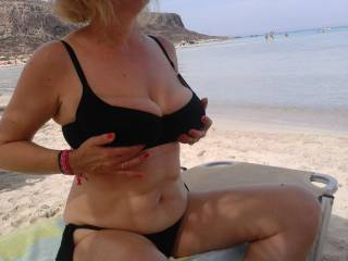 The guy next to us on the beach was feeling horny watching at my tits ...later on He was cumming on my nipples while my hubby was watching us