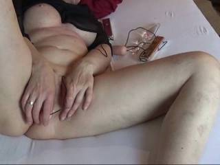 I love watching BDSM-Videos and masturbate. So what you hear in the background is the video. This video is about 30 minutes after I start with masturbation and I allready had many orgasm.  Watch my first orgasm and you will see that I squirt when I cum