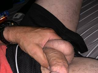 My Balls were hanging as low as my soft cock was so grabbing both with one hand seemed appropriate so I did it!! Much to my pleasure my wet little gf was masturbating ... And soaked the bed when she saw me do it spontaneously!