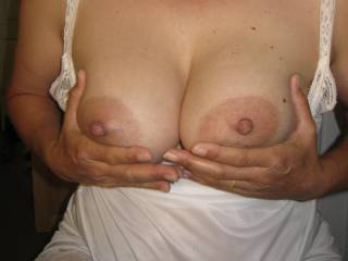 Just holding out those tits for lots of cum!