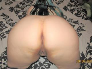 My wife\'s nice fat ass from the back with her chubby pussy peeking out at the camera - who\'d like to go balls deep and give her a proper pounding?