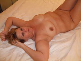 """Oh yeah, you bet she's hot enough to lick, suck, nibble and fuck all night long!!!   Love her innocent face, as in """"don't know why i'm laying here naked.. . .?"""""""
