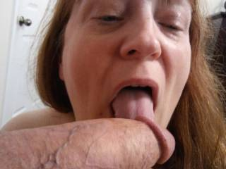 I might as well start at the tip of Hubby's luscious, thick and juicy cock, and work my way up that lovely engorged shaft of his. Mmm... I love sucking cock!