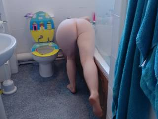 Another shot of wife's beautiful round ass while naked cleaning