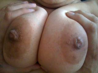 Here I am squeezing her big latina tits.  Aren\'t those nipples sexy?  This pic makes me want to go and put my dick between them right now.  What do you think?