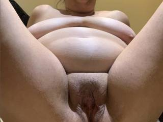 love to be spread wide opened showing my beat up, cummy wet pussy while my saggy tits flop down on my big chubby fat belly rolls.....