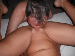 Our swinger friend eats out my pussy when he came around for a threesome.