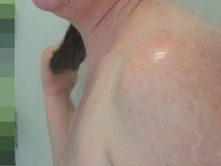 Heavy milk filled lactating breasts hanging out in the shower