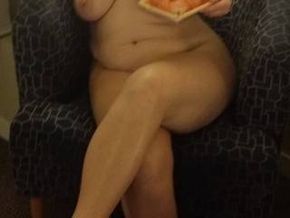 Her enjoying sushi in the nude.
