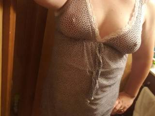 E posing in a short see through gown