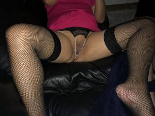 Spreads for him on the couch so he can see my shaved wet cunt