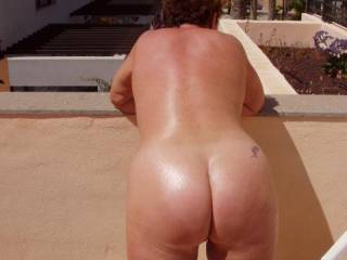 Now that's the kind of picture I love seeing...a naked ass OUTSIDE, where people just might see you.  I wish that just once I'd get people like you guys for our neighbors! And let me say again...I LOVE Your naked ass.