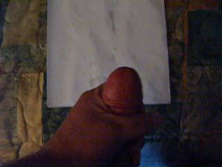 Stroking my cock while watching a amateur swingers video....check out the cum shot!  Over shot the paper towel!!!