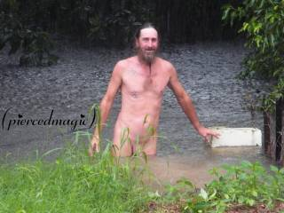Jim dick deep in our flooded back yard, hope there's no short legged, long nosed, swamp dogs in there!! lol!!!