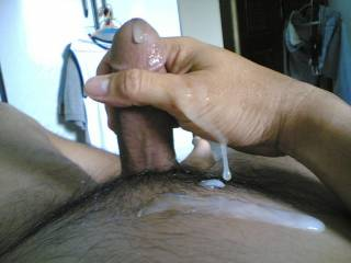 ooh....it feels so good after emptying all the cum from my aching balls, and now to squeeze out every drop of cum from my shaft n cockhead.....will not stop stroking until the entire cock is well drained of cum......not to waste a drop.