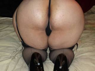 May I climb up behind pull your thong to the side grab hold of your hips slide my cock deep inside then watch you work that lovely ass