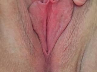 Spreading her pussy after my dick has been in it