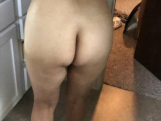 Caught my wife somewhat bent over.  She has a nice milf ass.