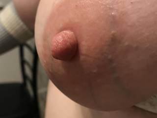 Kiki's nipple after taking the rubber band off. She LOVES having her nipples sucked after taking them off. Any ladies want to suck Kiki's nipples?