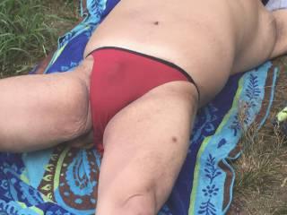 string bikini, park sunbathing,bikini