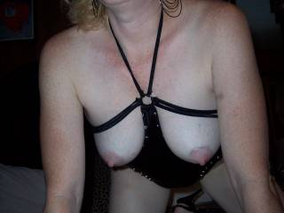 Love pics like this where the tits are exposed in open lingerie, especially when they are let to hang like here.  Would love to be underneath you sucking on those sweet nipples.