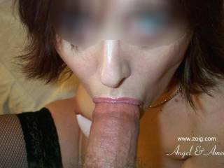 I just can't get enough of seeing this hot sexy woman with a cock in her sexy mouth....I love how her mouth hold a cock...I wish it was my cock in her mouth looking up at me with her sexy blue eyes.  G