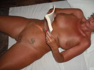 Reading my erotic novel in our bedroom at the Hotel in Fiji where we went for a romantic holiday. Every time I read it I was so turned on I just wanted my lovely Hubby to fuck me deep and hard with his beautiful smooth thick cock.
