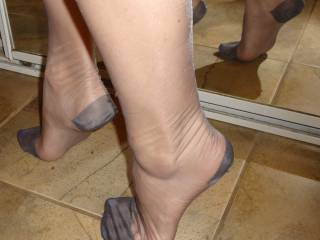 Lisa's sexy legs and feet in grey stockings.