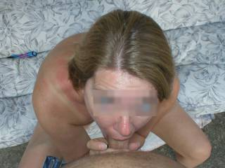 Blowjob on the patio. Even blurred, you can see how blue her eyes are