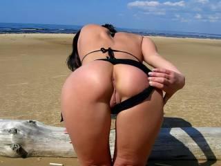 Teasing hubby on the beach.