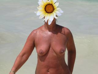 mmmmm, the view is orgasmic..xxx   A superb figure, a real hot girl..xxxx   Id love to be on the beach with your lovely wife, rubbing sun cream on,very seductivly.xxx