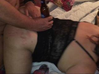 giving him a place to rest his beer while he fucks her